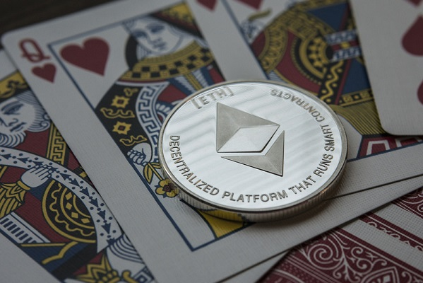 Ethereum coin on playing cards